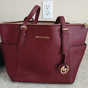 Maroon leather Michael Kors bag.